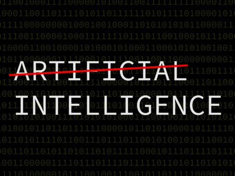 The phrase 'artificial intelligence' with the word 'artificial' crossed out.